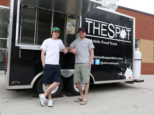 Owners Hunter Wilson, left, and Ben Norris operate their food truck, The Spot, from a private lot.