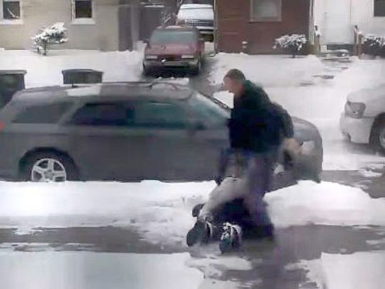 Carjack suspect Andrew Jackson being beaten by police in Detroit last month.