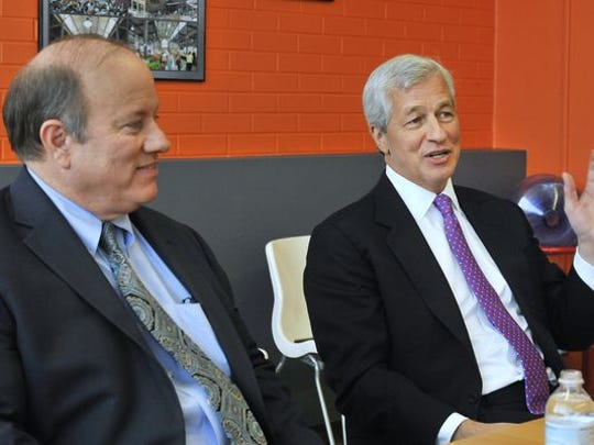 Jamie Dimon, CEO of JPMorgan Chase, left, and Mayor Mike Duggan have partnered on the company's investments.