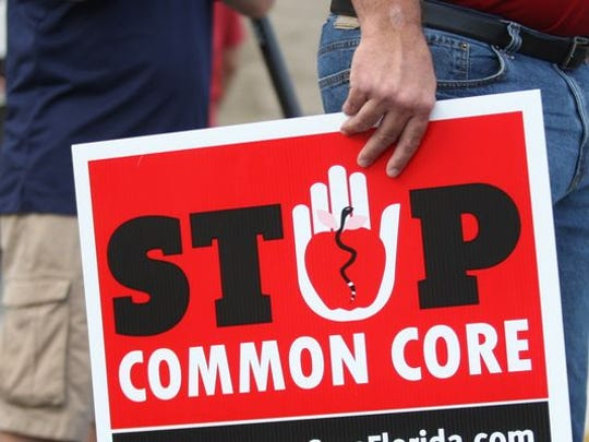 "Opponents of ""Common Core"" protest at a Lee County School Board meeting in 2014, prior to Florida's decision to revise the standards. Gov. Ron DeSantis said earlier this month that he would eliminate these ""Florida Standards"" and the state would craft new ones."