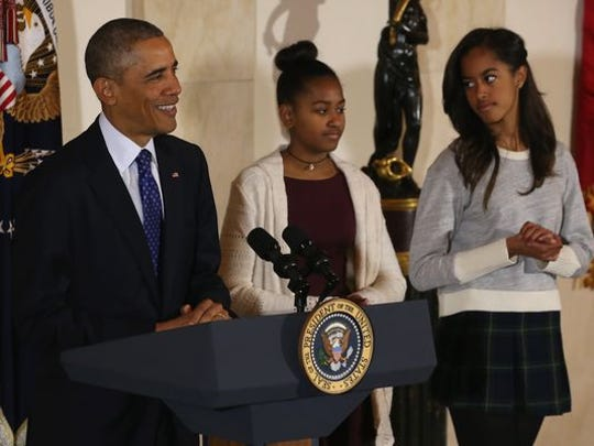 President Barack Obama, joined by his daughters Sasha, center, and Malia, speaks at the White House in Washington during the presidential turkey pardon ceremony, an annual Thanksgiving tradition, on Nov. 26.