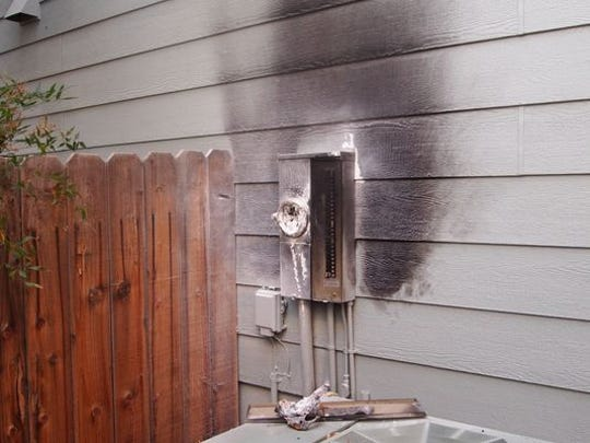 A burned smart meter is seen on a home in Reno.
