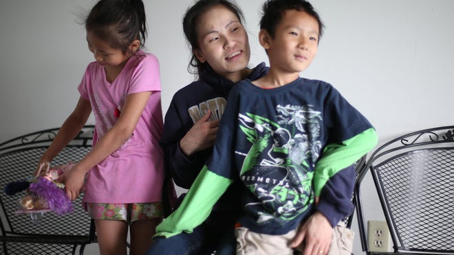 Mu Mu, a refugee of Myanmar (formerly Burma) plays with her 6-year-old son, Jobmu, and her 9-year-old daughter, Ju Aye, from their modest apartment in Des Moines. Way Moo committed suicide after being investigated for child abuse for disciplining Jobmu in December.