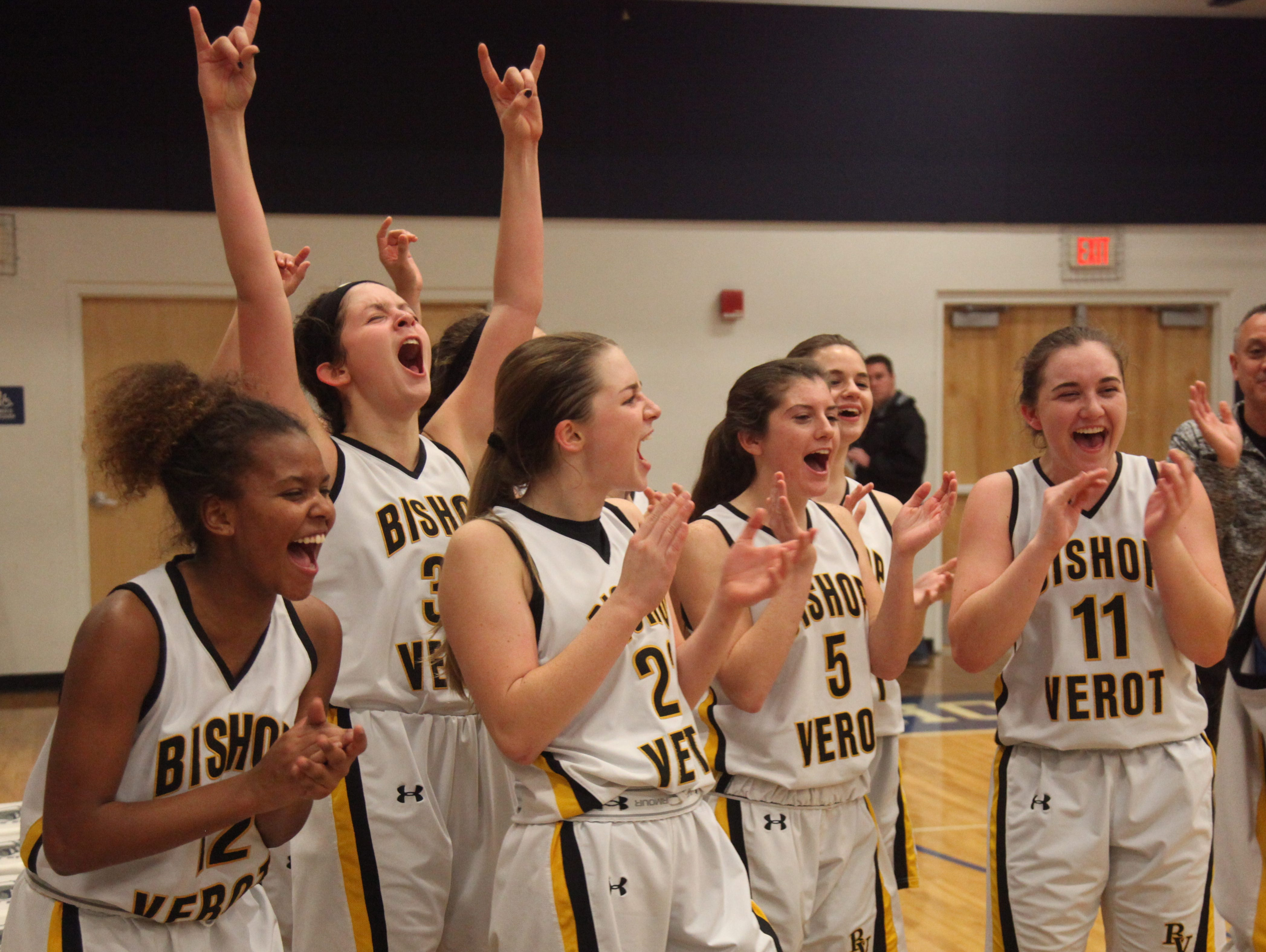 Members of the Bishop Verot High School girls basketball team celebrate after defeating Gateway Charter in the District 4A-10 finals on Thursday at Oasis High School.