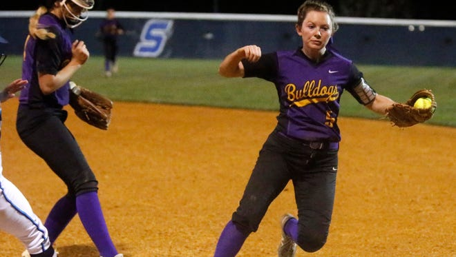 Smyrna's Katie Killen beats a runner to first base during a recent game. Killen was named District 7-AAA MVP.