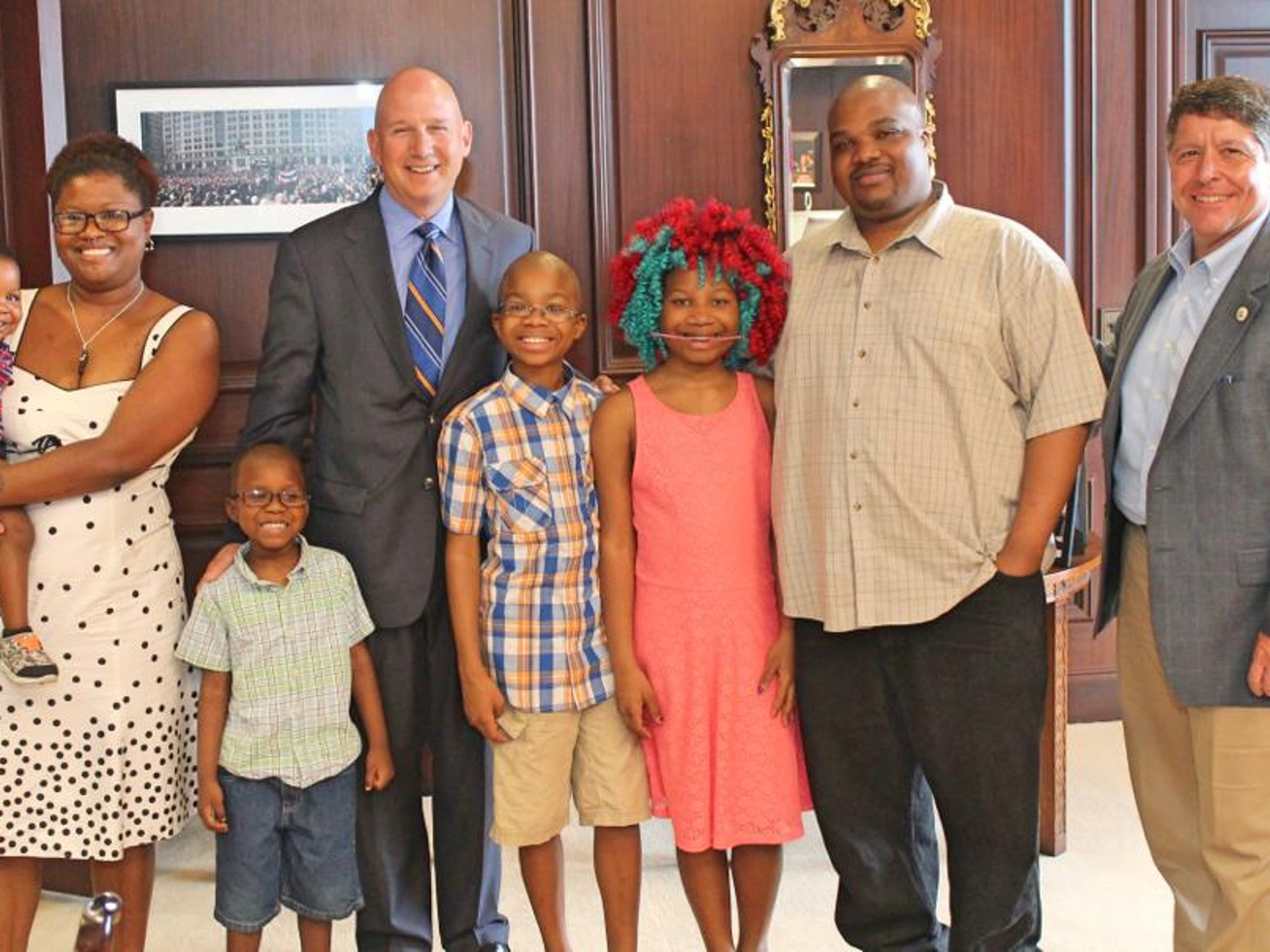 The Neals (from left to right) Thane, DeShanna, Hyperion, Lu, Trinity and Chris pose with former Governor Jack Markell and State Rep. Paul Baumbach in 2016.