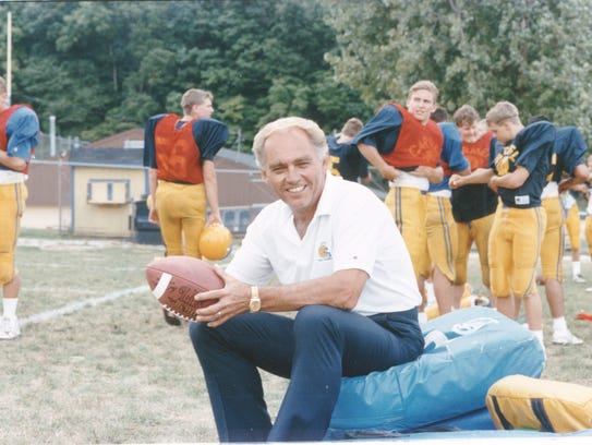 Jim Belden as the head football coach at Carmel High