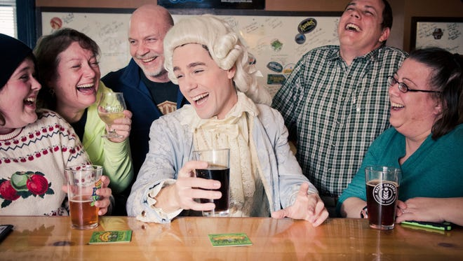 Wolfgang Amadeus Mozart, as portrayed by actor Allen T. Law, shares a beer with some locals at the Thirsty Monk. That's certainly a dark Highland brew he's got in his hand, since Highland Brewing is a sponsor of the festival and hosts the pre-opening party on Saturday.