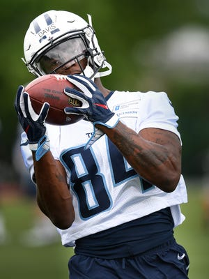 Titans receiver Corey Davis pulls in a catch during a rookie minicamp at St. Thomas Sports Park on May 12, 2017.