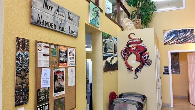 Wanderlust Cafe in Cocoa Village is a bright, cheerful place with original artwork on the walls.