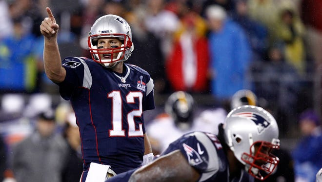 New England Patriots quarterback Tom Brady (12) is back at No. 1 in this week's NFL Rankings by Roy Lang III