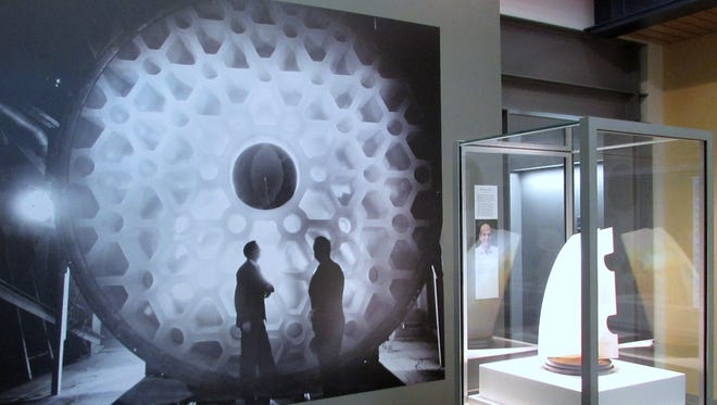 A display on the 200-inch glass disk made by Corning Glass Works for the Hale Telescope in California is part of a new exhibition on display at the Corning Museum of Glass Rakow Research Library.
