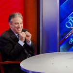 "Fox News Channel host Bill O'Reilly points across the table at ""Daily Show"" host Jon Stewart, on the set of the ""The O'Reilly Factor,"" Wednesday, Feb. 3, 2010 in New York."