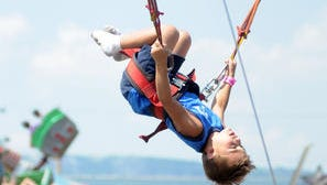 Michael Ryan, Jr., 7, of Brick, NJ, rides the Euro Bungy during the final day of the Ulster County Fair Sunday, August, 8, 2010, in New Paltz.