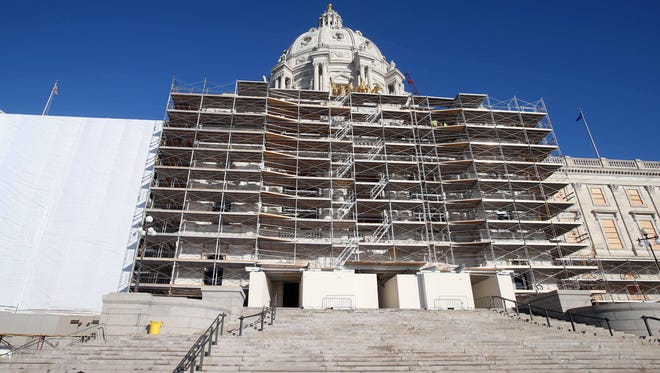 jim mone/AP file Protective wrap and scaffolding hide the graceful lines of the state Capitol as the massive renovation continues in St. Paul. Gov. Mark Dayton and officials overseeing the makeover met Wednesday to wrestle over office space. FILE - In this Nov. 25, 2014 file photo, protective wrap covering, left, and scaffolding hid the graceful lines of the Minnesota state Capitol as the massive renovation continues in St. Paul, Gov.Minn. Mark Dayton and top officials overseeing the state Capitol's grand makeover met Wednesday, Jan. 14,  to sign off on the final phase of work. (AP Photo/Jim Mone,File)