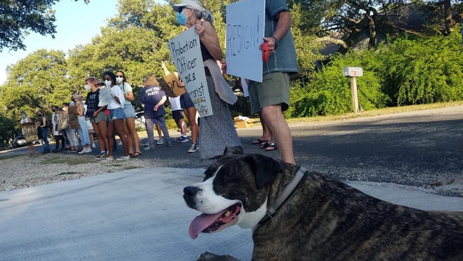 "Protesters in Hays County gathered at the residence of Woodcreek Mayor Gloria Whitehead on June 21 to call for her resignation after a Facebook post in which she called the Black Lives Matter movement a ""threat to our lives."" The Woodcreek City Council is expected to discuss its rules for meetings Friday after Whitehead blocked residents from addressing her social media comments."