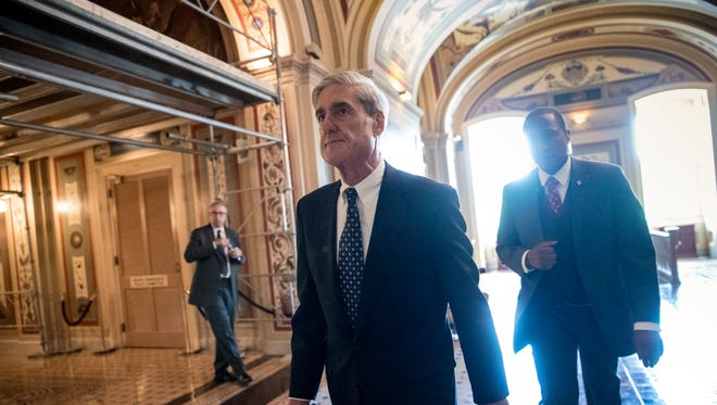 In this June 21, 2017, file photo, special counsel Robert Mueller departs after a closed-door meeting with members of the Senate Judiciary Committee about Russian meddling in the election and possible connection to the Trump campaign, at the Capitol in Washington. As Congress returns to Washington, a web of President Donald Trump's family and associates will be in the crosshairs of committees investigating whether his campaign colluded with Russia last year, as well as of the high-wattage legal team assembled by Mueller.