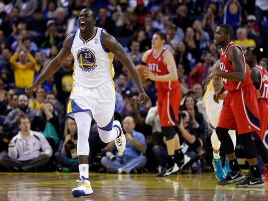 Golden State Warriors' Draymond Green, left, celebrates a score against the Atlanta Hawks during the second half of an NBA basketball game Friday, March 7, 2014, in Oakland, Calif. (AP Photo/Ben Margot)