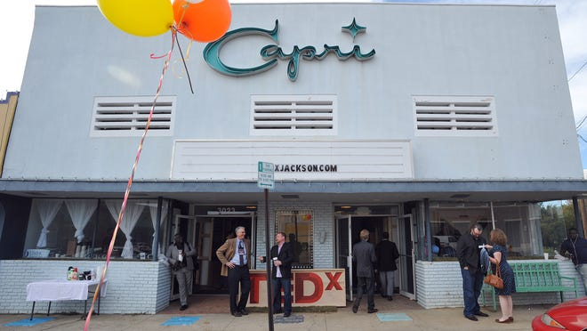 People enter the Capri Theater in Jackson for a TEDx talk Thursday.