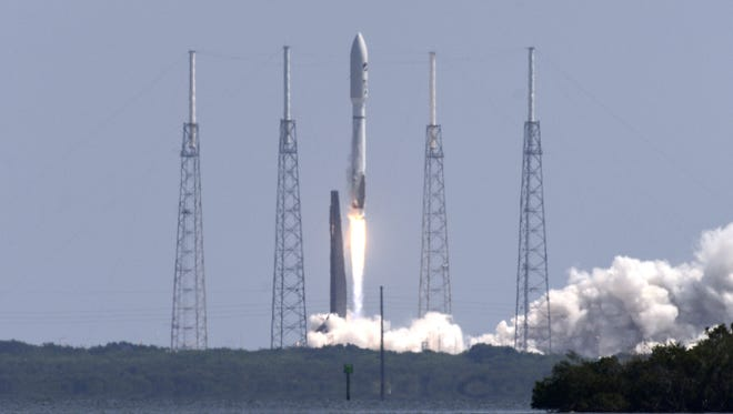 A United Launch Alliance Atlas V rocket lifts off from Cape Canaveral Air Force Station Wednesday, May 20, 2015.  The rocket is carrying the X-37B space plane for the US Air Force as well as 10 CubeSats and the Planetary Society's LightSail Mission.
