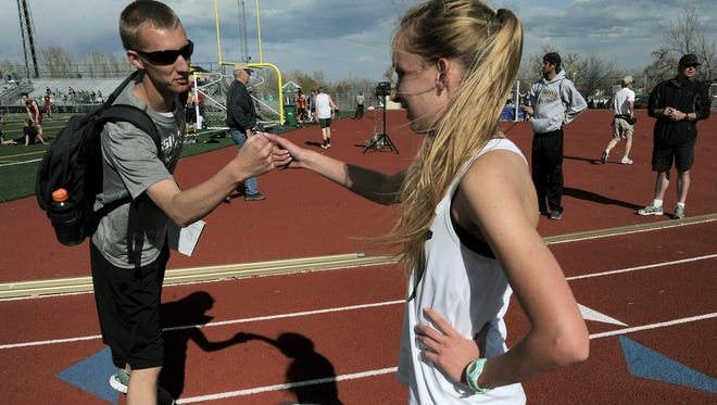 Forrest Vaughan, left, is leaving Fossil Ridge after five years as the cross country coach. He also worked as a track assistant.