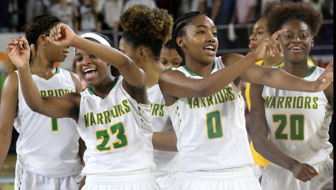 Memphis Central's Kynadi Kuykendoll (23), Bionka Massie (0) and Montyria Bennett (20) celebrate their 72-59 victory over Dickson County during the Semifinal round of the Class AAA State Tournament on Friday, March 10, 2017.