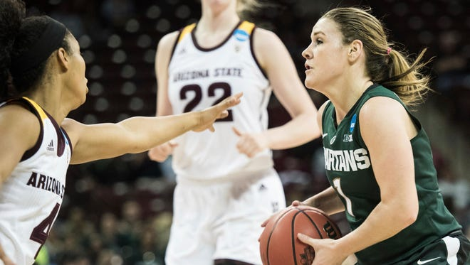 Michigan State guard Tori Jankoska (1) drives to the hoop against Arizona State guard Kiara Russell (4) during a first-round game in the women's NCAA college basketball tournament Friday, March 17, 2017, in Columbia, S.C. (AP Photo/Sean Rayford)