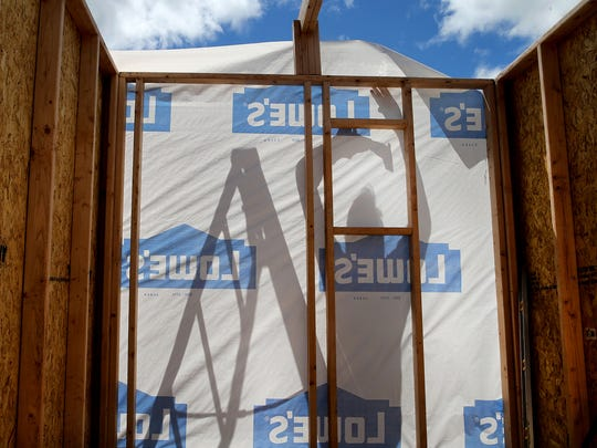 House wrapping is nailed up to a tiny cottage being built in Port Orchard on Saturday.