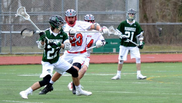 Pleasantville's Brian Reda (22) unleashes a shot with