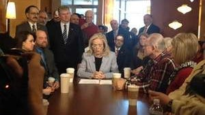 Debbie Dingell, center, speaks Friday after announcing her candidacy for the congressional seat her husband, John, held for 58 years.