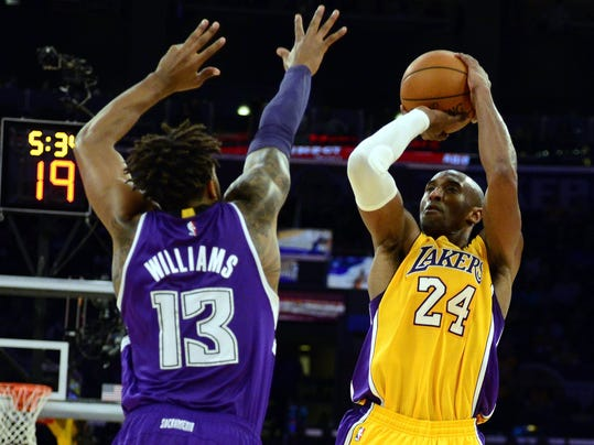 NBA/NHL roundup: Bryant leads late charge by Lakers