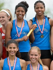 Cedar Crest's girls 4x100 meter relay team of Destinee Holloman, DeAsia Holloman, Ariel Jones and Taylor Menser took first and set a county record at the annual Lebanon County Track and Field meet at Lebanon High School on Saturday.