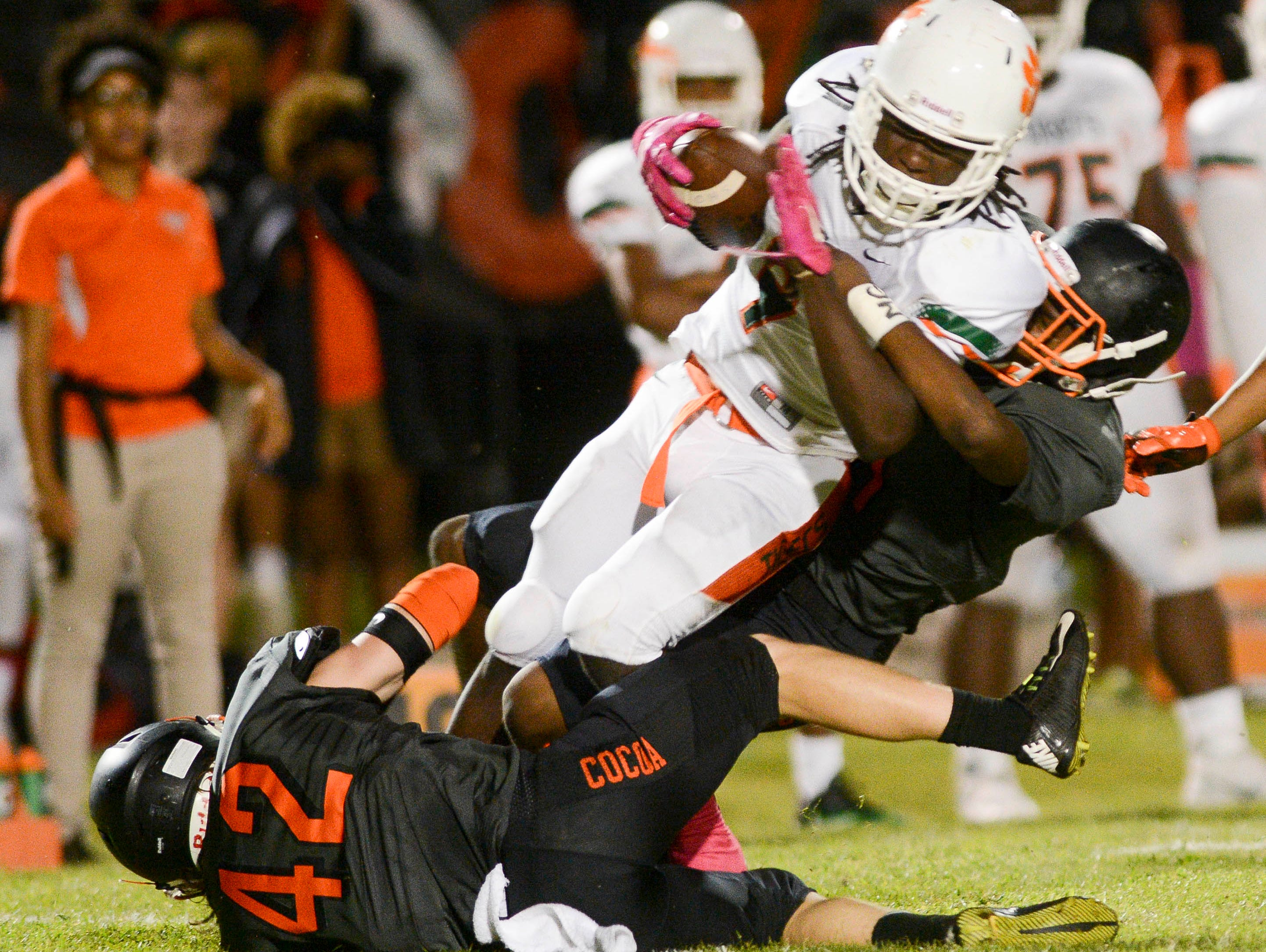 Jones QB Tyrese Jones is taken down for a loss by Daquan Evans of Cocoa during Friday's game.