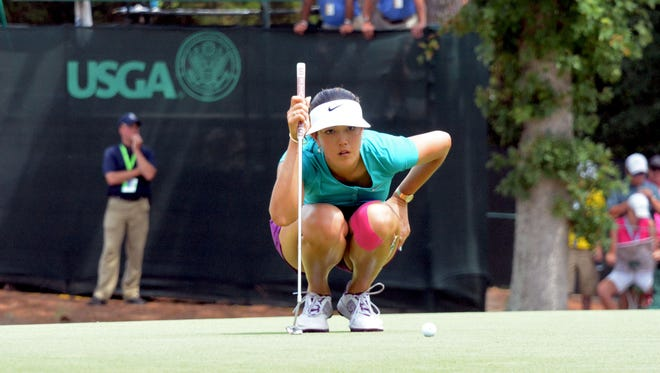 Michelle Wie reads a birdie putt on the sixth hole during the final round of the U.S. Women's Open.