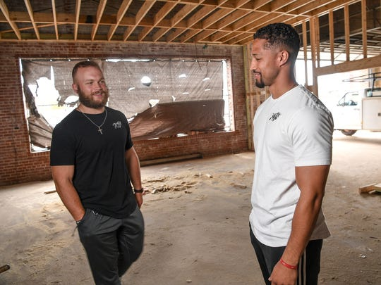 Business partners Ben Boulware, left, and Marcus Brown, talk about their plans for The Junkyard fitness center in downtown Anderson.