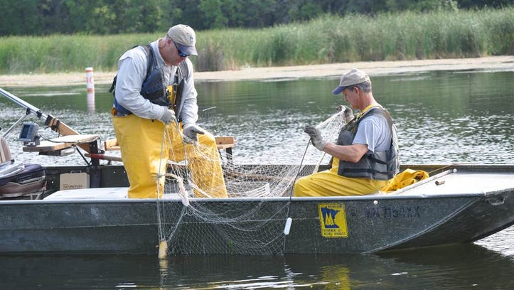 Joe Stewig (left), the Montrose area fisheries supervisor with the Department of Natural Resources, worked in 2013 with fisheries technician Brad Mass to conduct lake surveys on the Horseshoe Chain of Lakes.
