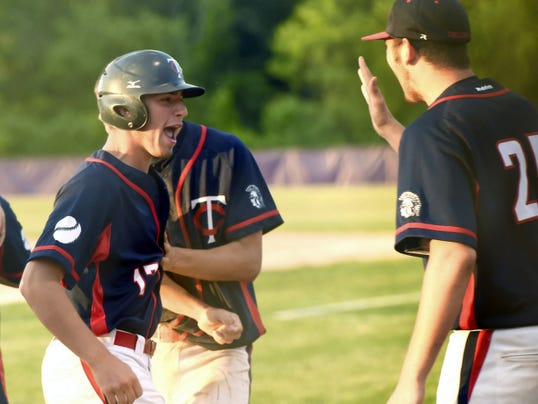 Chambersburg's Johnnie Myers (17) is congratulated by teammates after scoring a run against Warwick during the District 3-AAA baseball semifinal on Tuesday. The Trojans scored five runs in the fourth inning and beat the Warriors 6-1.