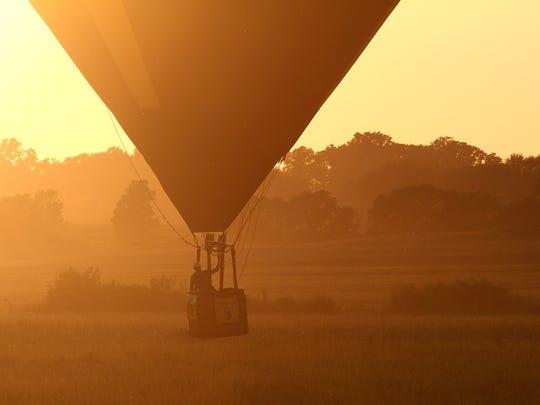 Jeremy Rubin of Ankeny pilots Legacy over a farm field