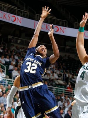 Notre Dame's Jewell Loyd (32) shoots against Michigan State's Jasmine Hines (4) during the second half of an NCAA college basketball game, Wednesday, Nov. 19, 2014, in East Lansing, Mich. Loyd led Notre Dame with a game-high 28 points in a 71-63 win. (AP Photo/Al Goldis)