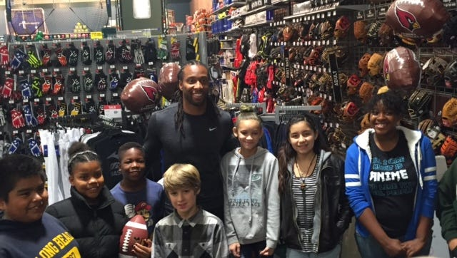Arizona Cardinals wide receiver Larry Fitzgerald spends time shopping with children from Big Brothers Big Sisters of Central Arizona on Dec. 20, 2016, at Dick's Sporting Goods at Scottsdale Fashion Square.