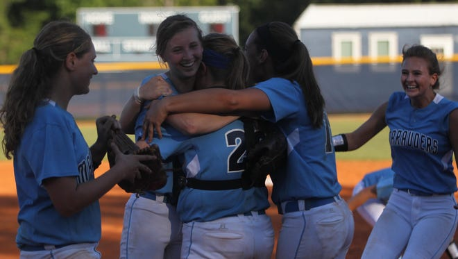 Maclay catcher Haley Harrison hugs pitcher Kenzie Mullins as teammates rush up after the Marauders beat NFC 6-4 on Tuesday in a Region 1-3A final to advance to the state tournament.
