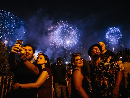 Fireworks explode over the East River as part of an