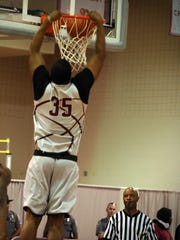 Isaac Taylor throws down a dunk during Hawk Hysteria