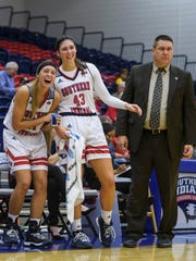 USI's Morgan Sherwood (11) and USI's Kacy Eschweiler
