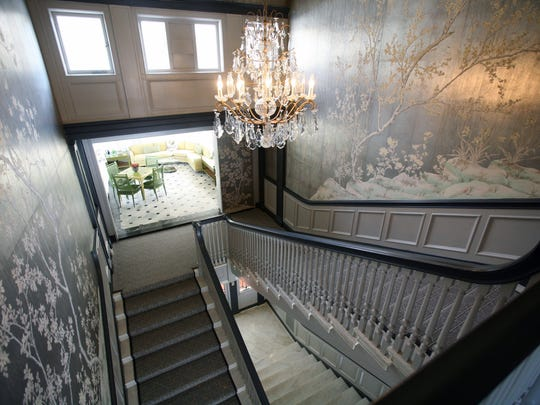 The grand staircase in a 1914 mansion up for auction on Cooper Road in Scarsdale.