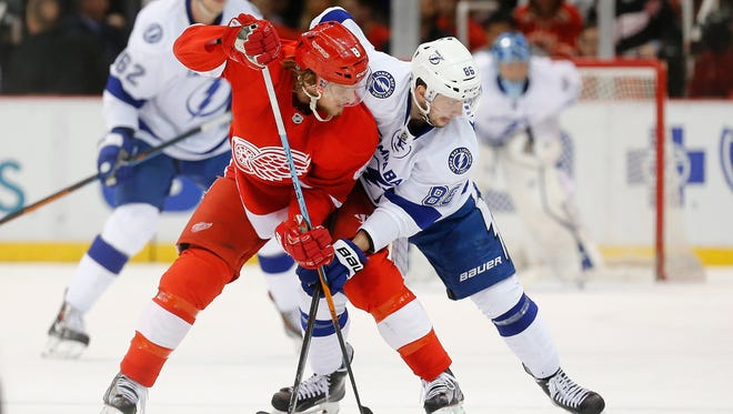 Detroit Red Wings left wing Justin Abdelkader, left, wraps up Tampa Bay Lightning right wing Nikita Kucherov on March 28, 2015.