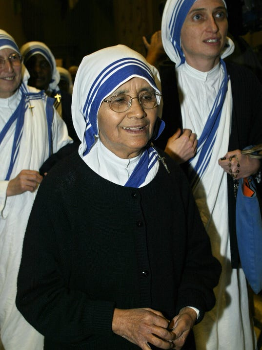 Sister Nirmala Joshi (C), superior of th