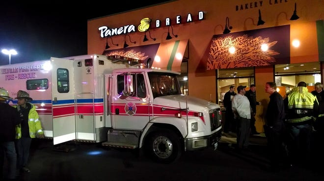 First responders stand outside Panera Bread's store at the Walt Whitman Mall in Huntington station, N.Y., on Feb. 22.