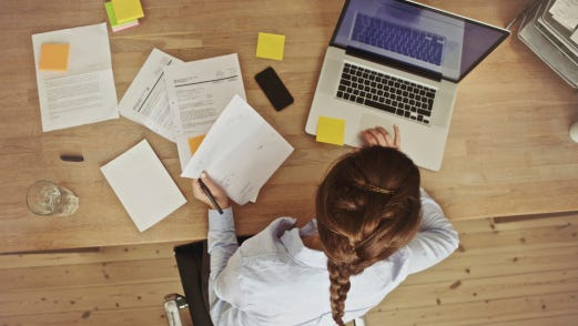 Businesswoman working at her desk at home.