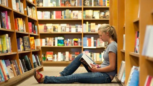 Girl sitting in bookstore